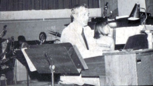Ants Sulev on the organ with stage band behind
