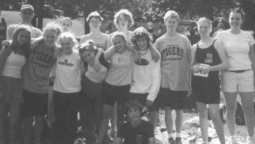 (Click to magnify - very poor original) NOT explicitly captioned ... 5 runners represented USS at OFSAA ... they were: M